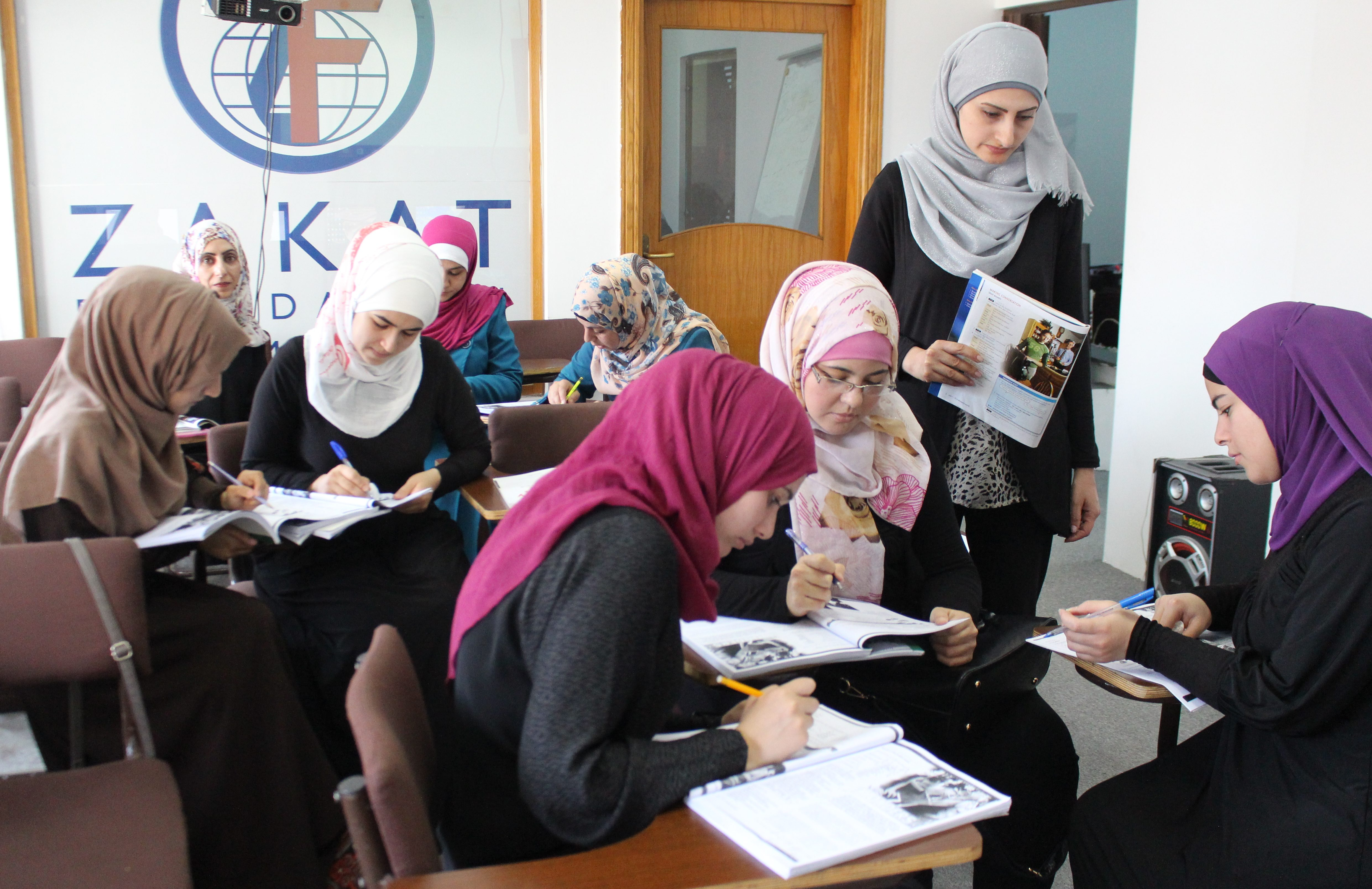 Refugee women from Syria take classes at the Zakat Foundation of America Vocational Training Center