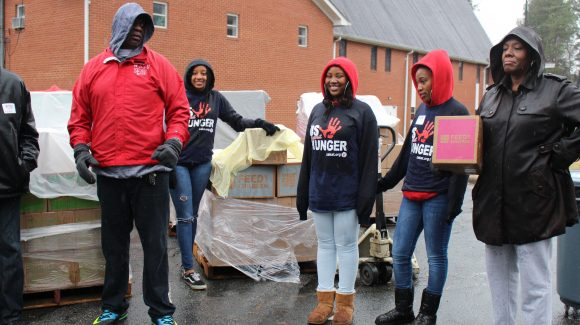Durham rain doesn't stop volunteers from blessing others