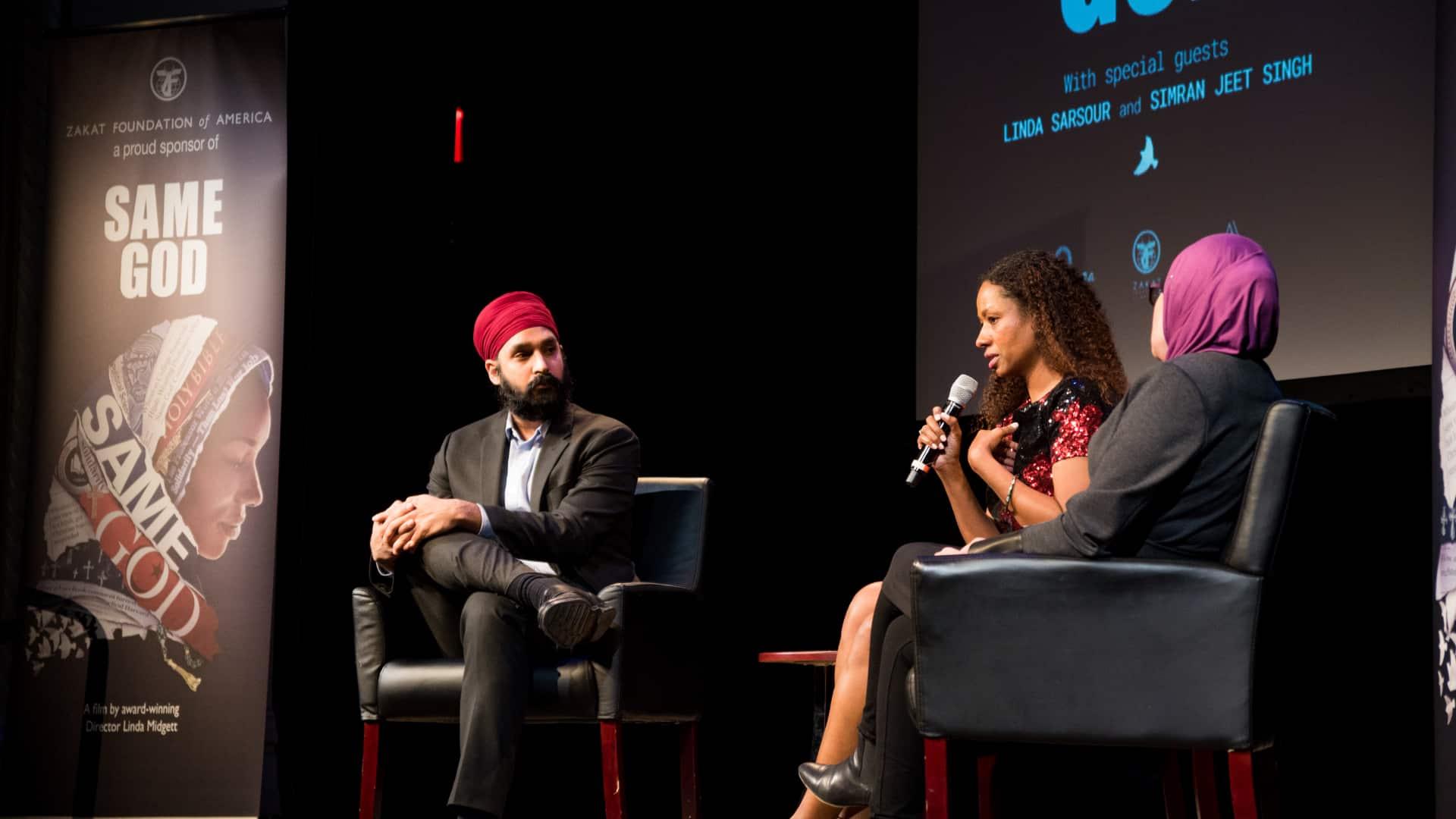Linda Sarsour and Simran Jeet Singh talking at a panel
