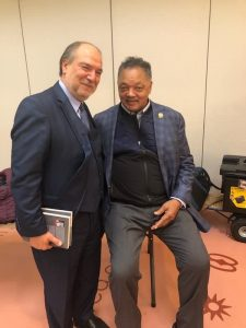 Halil Demir pictured with Reverend Jessie Jackson