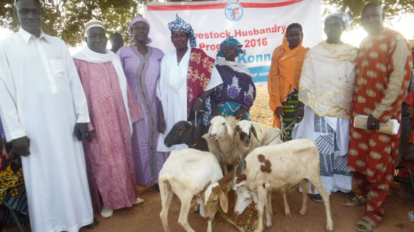 Beneficiaries with livestock gifted through ZF's animal husbandry development program.