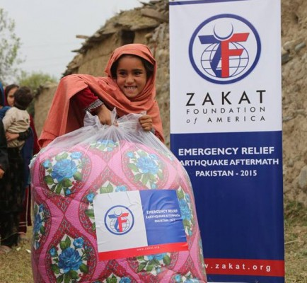 adorable little girl holding a big bag from the emergency relief