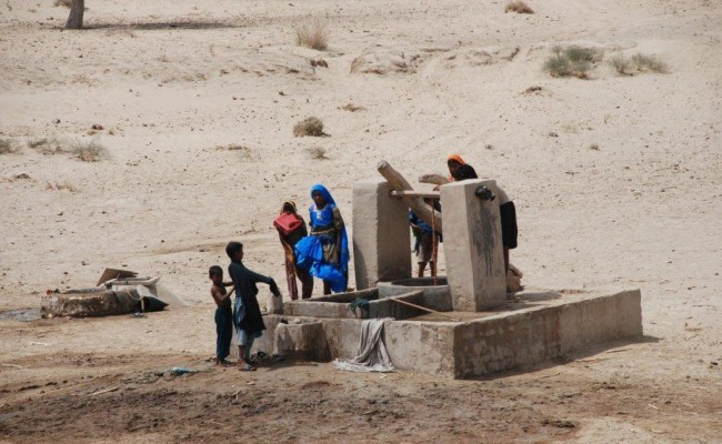 Residents of Thar pump water from a well.