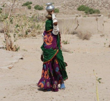 A woman carries sustenance to her family.