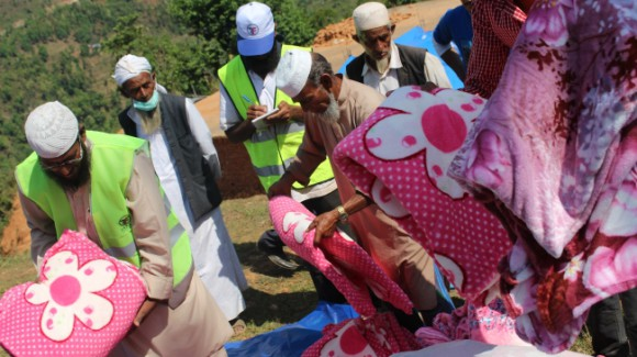 zakat foundation relief team distributing kits