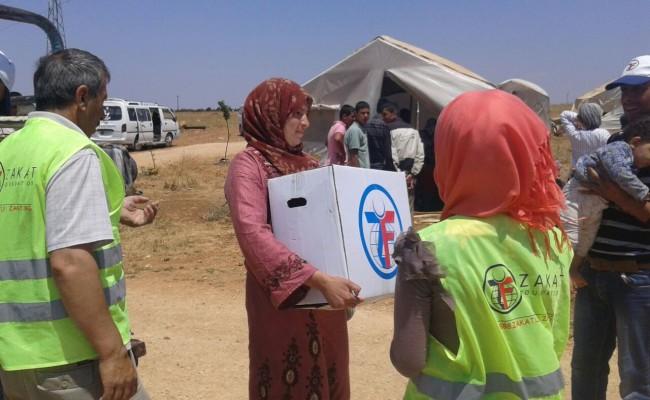 zakat foundation team member handling a box of supplies