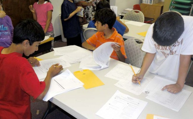 Young students participating in after school tutoring program.