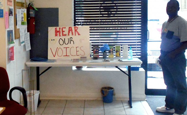 sign that says hear our voices